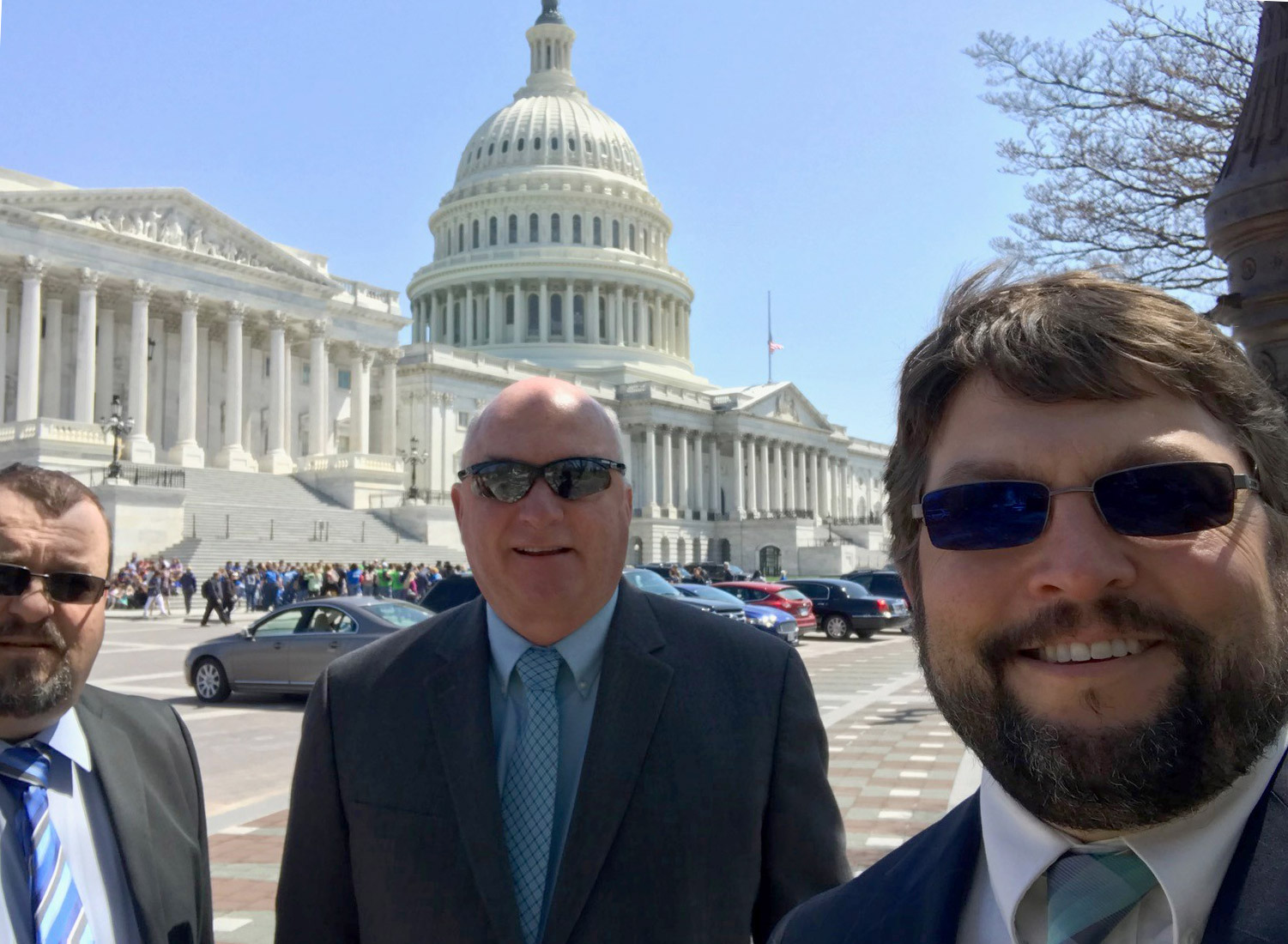 Wayne Lovelis, John Alston, and Nate Weisenburger outside the Capitol Building during the AWWA's 2018 Water Matters! Fly-In